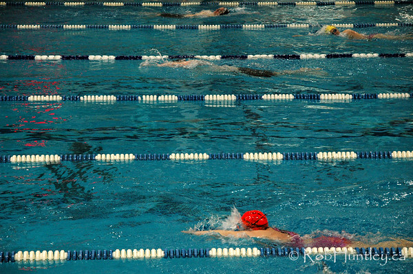 Nepean Sportsplex pool during the warm-up at the Ontario Masters Swimming Championships in Ottawa, Ontario. This image has high grain/digital noise. © Rob Huntley