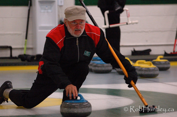 Curling action at the Granite Curling Club of West Ottawa. This session took place in a low light situation. There is a high level of digital noise in this photograph.  This image is NOT model released. No products are available for purchase.  © Rob Huntley