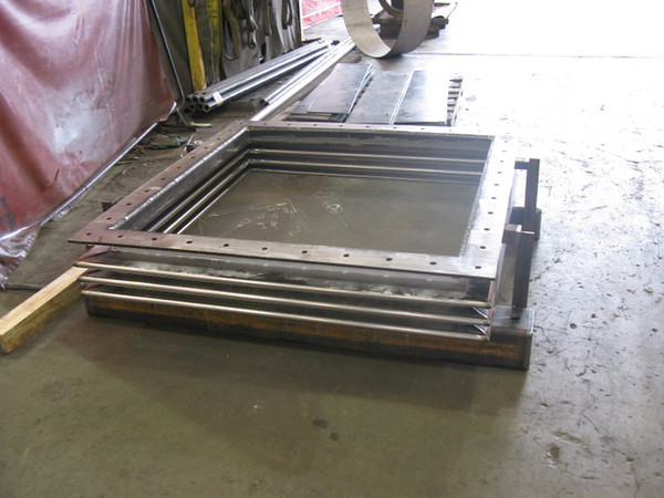 Single rectangular stainless steel expansion joint with mitered corners