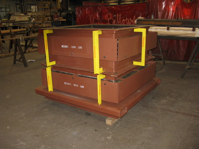 Rectangular expansion joints with stainless steel bellows and carbon steel protective covers