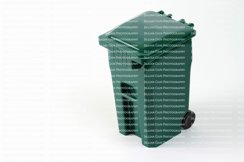 Isolated green wheeled garbage can