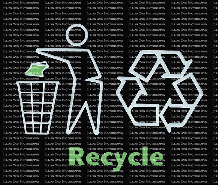 Recycle sign with man throwing green trash into garbage