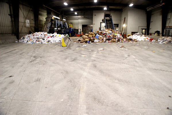 The Courier photographer, Rachel Leathe chose to focus on the Ottumwa Recycling Center for one of her Thursday photo pages.