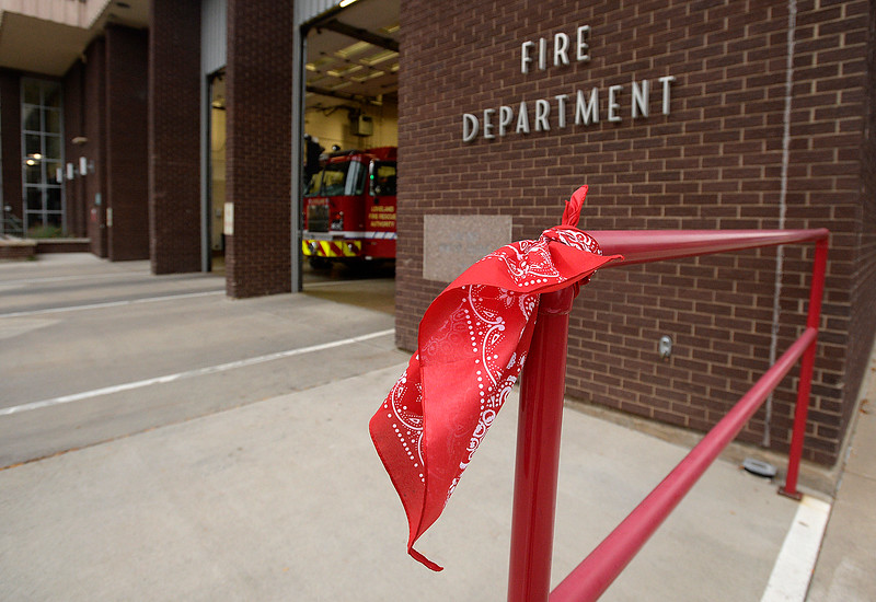"A red bandana hangs near Loveland Fire Rescue Authority station 1 Monday, Sept. 11, 2017, in downtown Loveland to alert first responders that Good Samaritan Society Loveland Village is giving out red bandanas and breakfast to first responders in Loveland to thank and honor them and the ""man in the red bandana,"" who helped carry people to safety from the World Trade Center in 2001 and perished in the attack. (Photo by Jenny Sparks/Loveland Reporter-Herald)"