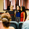 Isabella Ayapan, 8, Nicole Delgado, 8 and Giselle Cintron, 7, entertain the crowd with Christmas carols during the Red Kettle Kickoff at the Salvation Army in Fitchburg on Saturday morning. SENTINEL & ENTERPRISE / Ashley Green