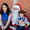 Nicole Delgado, 8, and little brother Adrian, 3, meet Santa during the Red Kettle Kickoff at the Salvation Army in Fitchburg on Saturday morning. SENTINEL & ENTERPRISE / Ashley Green