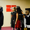 Anne Rich, Isabella Ayapan, 8, Nicole Delgado, 8, Giselle Cintron, 7, and Jaylen Bomeh, 5, entertain the crowd with Christmas carols during the Red Kettle Kickoff at the Salvation Army in Fitchburg on Saturday morning. SENTINEL & ENTERPRISE / Ashley Green