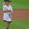 Today's kid pitcher waits for her autograph.