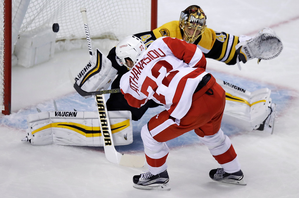 . Detroit Red Wings center Andreas Athanasiou (72) scores against Boston Bruins goalie Tuukka Rask during the first period of an NHL hockey game in Boston, Tuesday, Jan. 24, 2017. (AP Photo/Charles Krupa)
