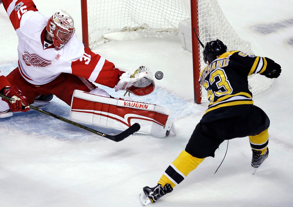 . Detroit Red Wings goalie Jared Coreau (31) reaches but can\'t get his glove on the puck on a goal by Boston Bruins left wing Brad Marchand (63) during the first period of an NHL hockey game in Boston, Tuesday, Jan. 24, 2017. (AP Photo/Charles Krupa)