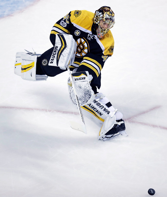 . Boston Bruins goalie Tuukka Rask (40) skates out of the crease to clear the puck during the first period of an NHL hockey game against the Detroit Red Wings in Boston, Wednesday, March 8, 2017. (AP Photo/Charles Krupa)