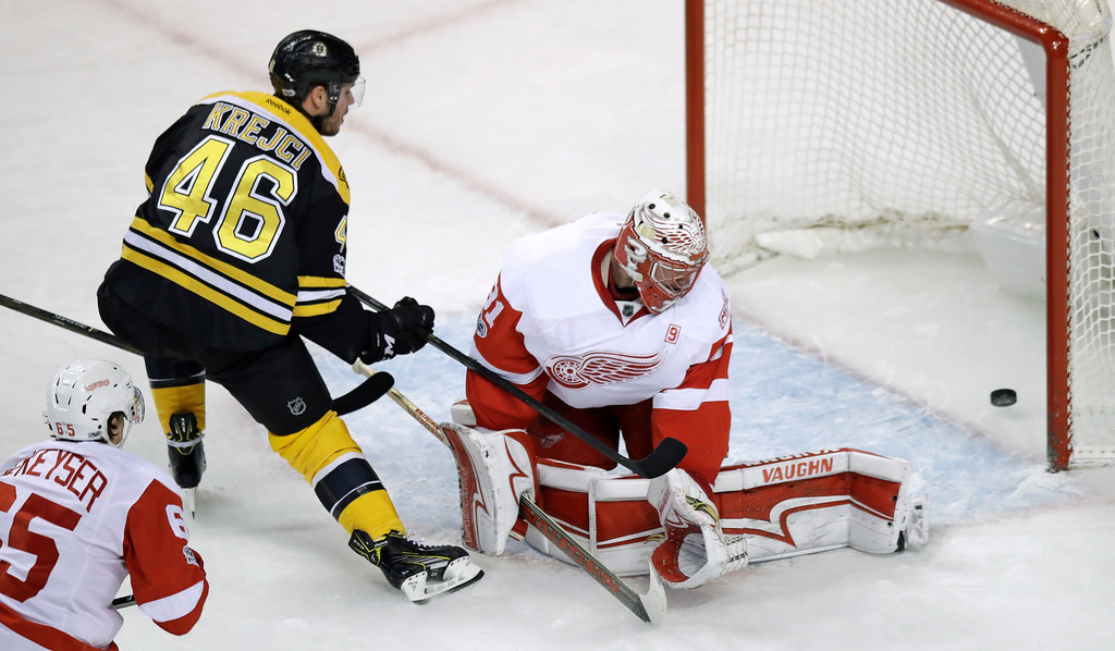 . Boston Bruins center David Krejci (46) pokes the puck past Detroit Red Wings goalie Jared Coreau (31) for a goal during the first period of an NHL hockey game in Boston, Wednesday, March 8, 2017. (AP Photo/Charles Krupa)