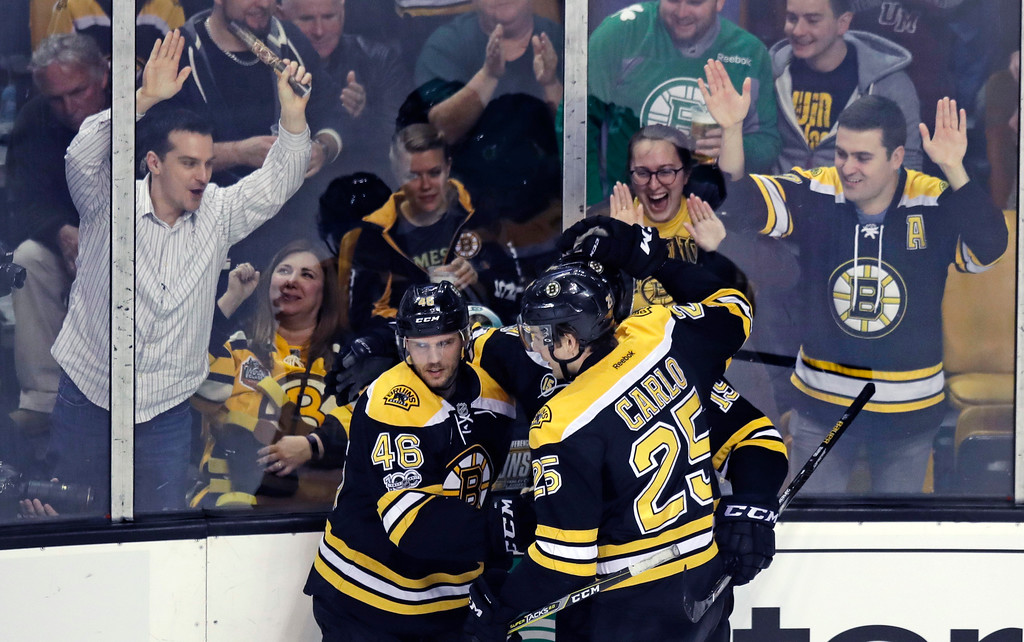 . Boston Bruins center David Krejci (46) is congratulated after his goal against Detroit Red Wings goalie Jared Coreau during the first period of an NHL hockey game in Boston, Wednesday, March 8, 2017. (AP Photo/Charles Krupa)
