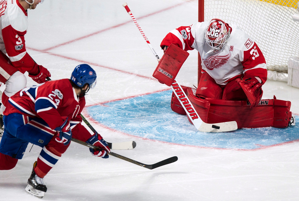 . Detroit Red Wings goalie Jimmy Howard (35) stops a shot from Montreal Canadiens\' Phillip Danault (24) during the second period of an NHL hockey game in Montreal on Tuesday, March 21, 2017. (Paul Chiasson/The Canadian Press via AP)