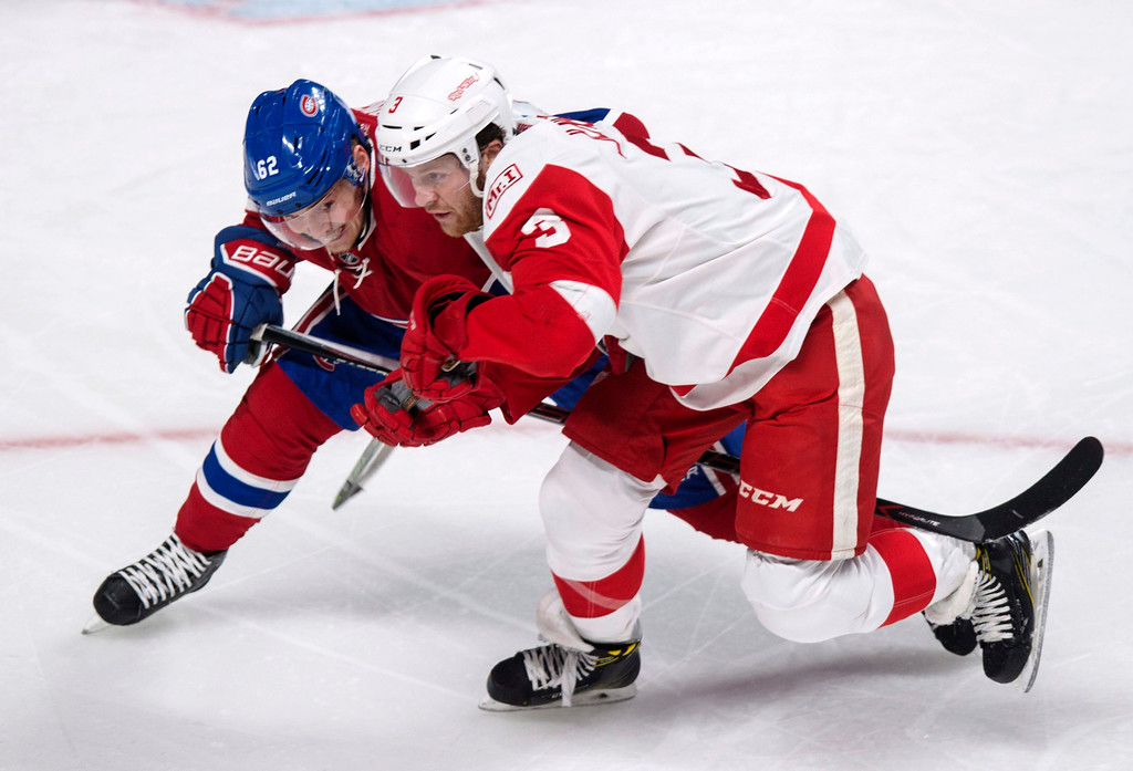 . Montreal Canadiens\' Artturi Lehkonen (62) shoves off Detroit Red Wings\' Nick Jensen (3) during the first period of an NHL hockey game in Montreal on Tuesday, March 21, 2017. (Paul Chiasson/The Canadian Press via AP)