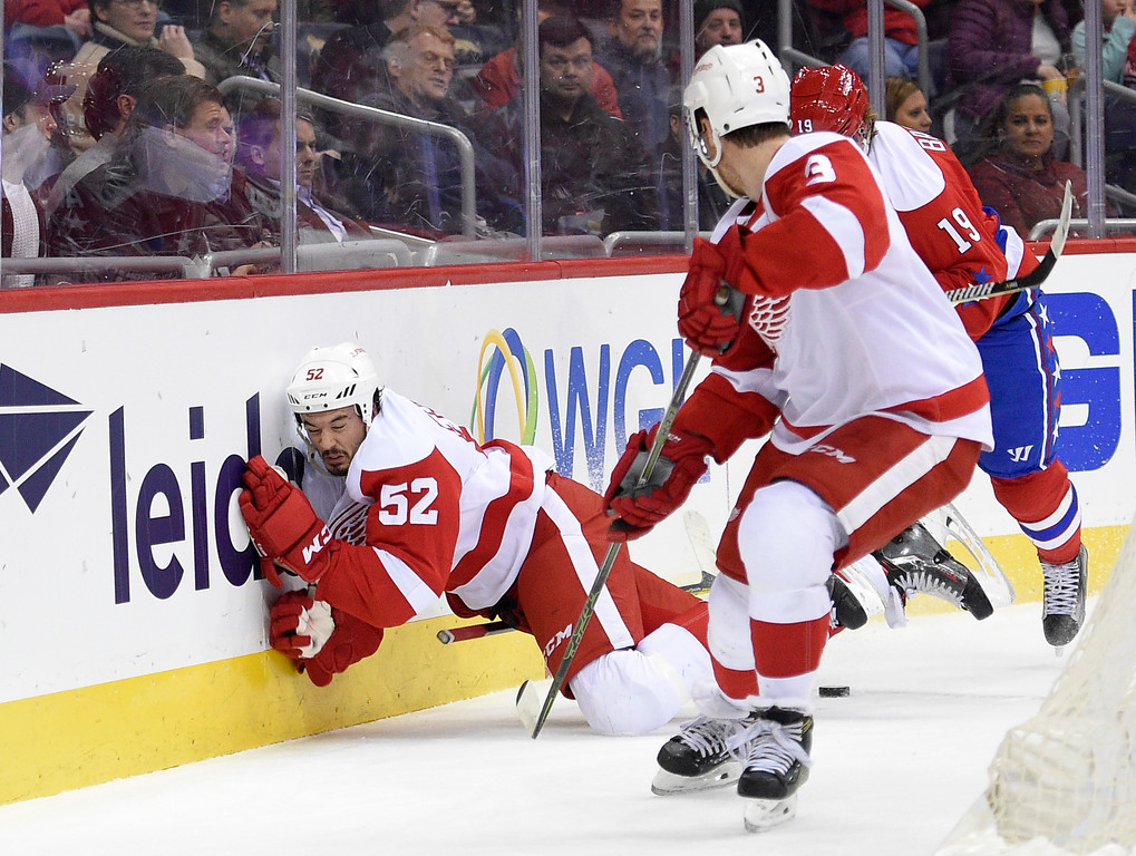 . Detroit Red Wings defenseman Jonathan Ericsson (52), of Sweden, slams into the boards during the first period of an NHL hockey game against the Washington Capitals, Thursday, Feb. 9, 2017, in Washington. Washington Capitals center Nicklas Backstrom (19), of Sweden, was called for boarding on the play. (AP Photo/Nick Wass)