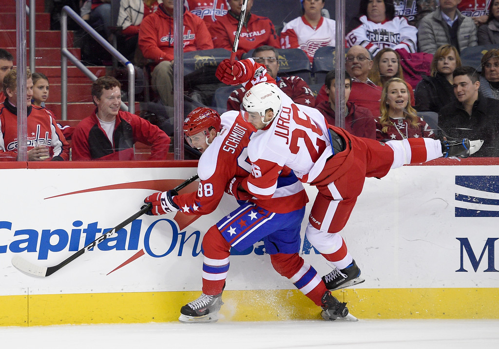 . Detroit Red Wings right wing Tomas Jurco (26), of Slovakia, gets upended against Washington Capitals defenseman Nate Schmidt (88) during the second period of an NHL hockey game, Thursday, Feb. 9, 2017, in Washington. (AP Photo/Nick Wass)