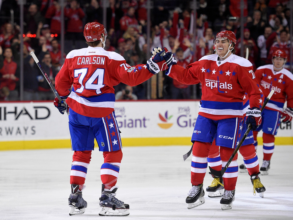 . Washington Capitals defenseman John Carlson (74) celebrates his goal with right wing T.J. Oshie (77) during the third period of an NHL hockey game against the Detroit Red Wings, Thursday, Feb. 9, 2017, in Washington. The Capitals won 6-3. (AP Photo/Nick Wass)