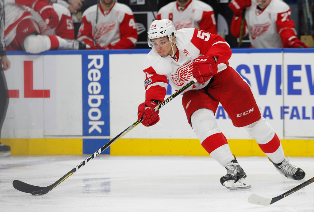 . Detroit Red Wings defenseman Alexey Marchenko (53) controls the puck during the second period of an the team\'s NHL hockey game against the Buffalo Sabres, Friday, Jan. 20, 2017, in Buffalo, N.Y. (AP Photo/Jeffrey T. Barnes)