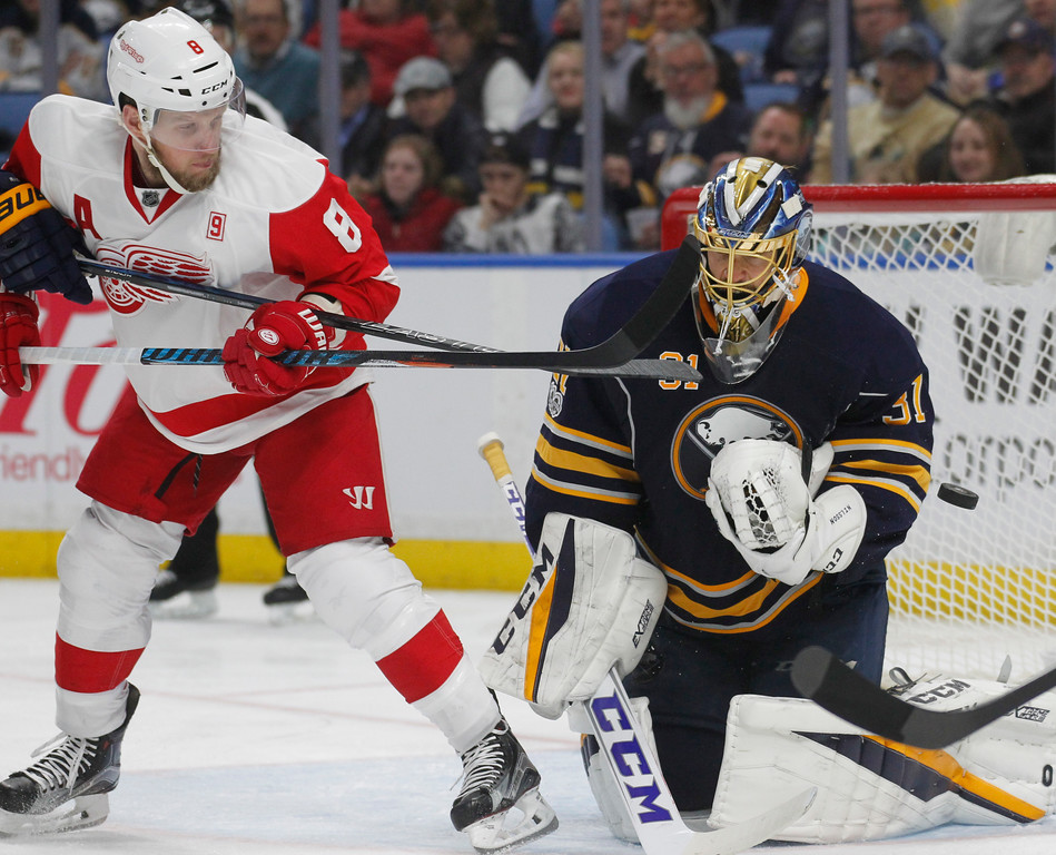 . Buffalo Sabres goalie Anders Nilsson (31) makes a save against Detroit Red Wings forward Justin Abdelkader (8) during the second period of an NHL hockey game, Friday, Jan. 20, 2017, in Buffalo, N.Y. (AP Photo/Jeffrey T. Barnes)