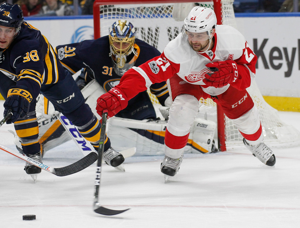 . Detroit Red Wings forward Tomas Tatar (21) reaches for the puck during the second period of an NHL hockey game against the Buffalo Sabres, Friday, Jan. 20, 2017, in Buffalo, N.Y. (AP Photo/Jeffrey T. Barnes)