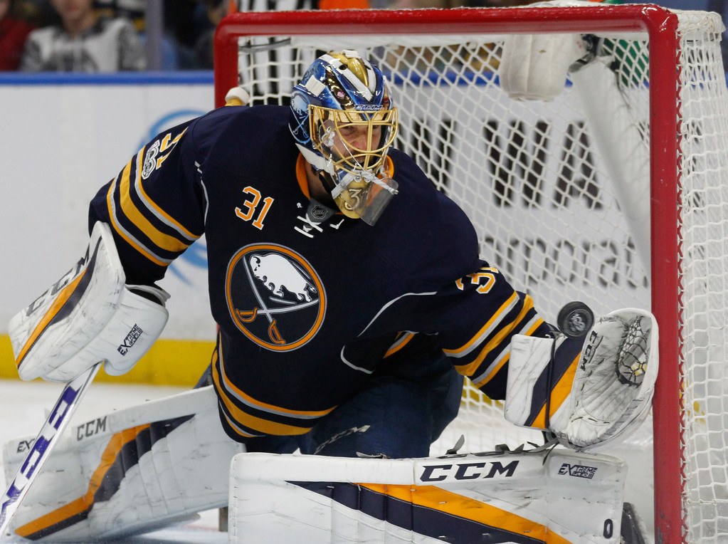 . Buffalo Sabres goalie Anders Nilsson makes a glove save during the second period of the team\'s NHL hockey game against the Detroit Red Wings, Friday, Jan. 20, 2017, in Buffalo, N.Y. (AP Photo/Jeffrey T. Barnes)