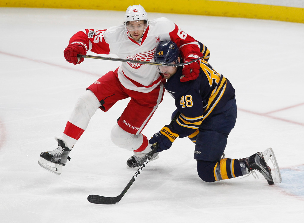 . Buffalo Sabres forward William Carrier (48) and Detroit Red Wings defenseman Danny DeKeyser (65) get tied up during the third period of an NHL hockey game, Friday, Jan. 20, 2017, in Buffalo, N.Y. (AP Photo/Jeffrey T. Barnes)