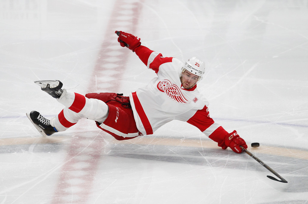 . Detroit Red Wings defenseman Mike Green falls to the ice during the third period of the team\'s NHL hockey game against the Buffalo Sabres, Friday, Jan. 20, 2017, in Buffalo, N.Y. (AP Photo/Jeffrey T. Barnes)