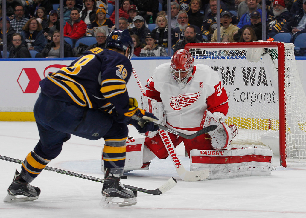 . Buffalo Sabres forward William Carrier (48) is stopped by Detroit Red Wings goalie Petr Mrazek (34) during the first period of an NHL hockey game, Friday, Jan. 20, 2017, in Buffalo, N.Y. (AP Photo/Jeffrey T. Barnes)