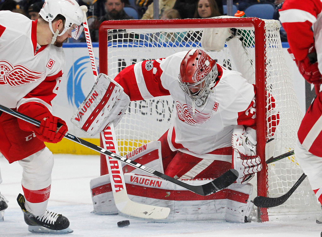 . Detroit Red Wings goalie Petr Mrazek (34) makes a pad save during the first period of the team\'s NHL hockey game against the Buffalo Sabres, Friday, Jan. 20, 2017, in Buffalo, N.Y. (AP Photo/Jeffrey T. Barnes)