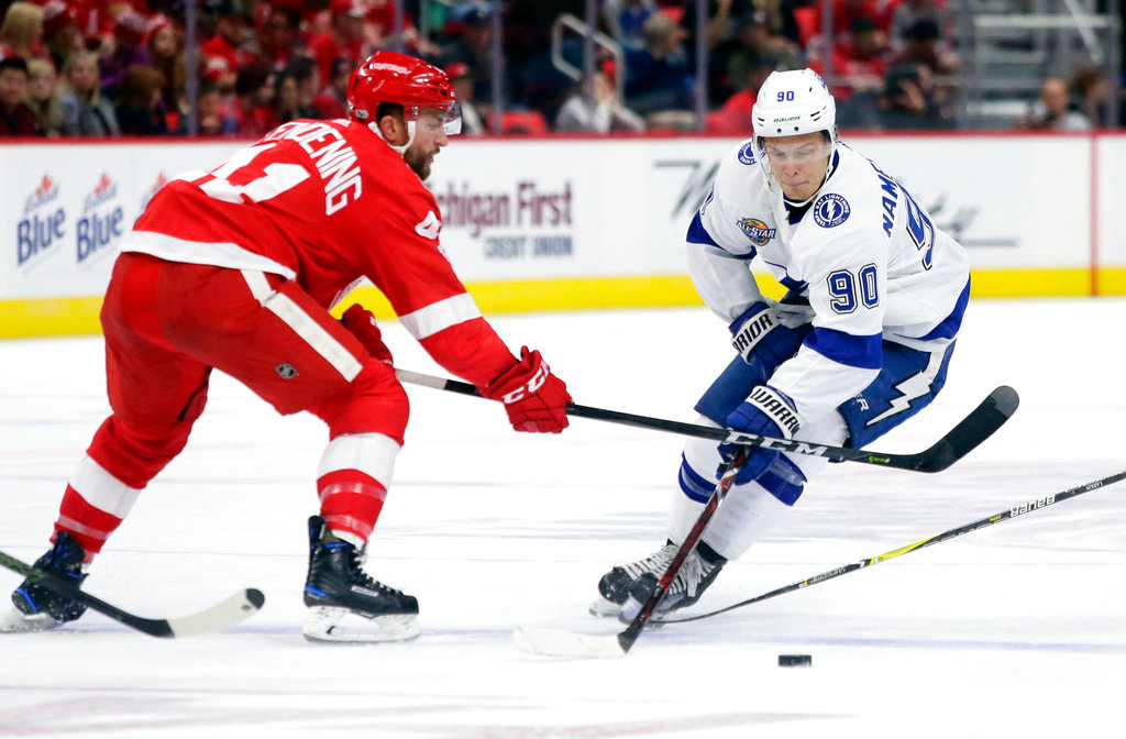 . Tampa Bay Lightning center Vladislav Namestnikov (90), of Russia, skates down the ice against Detroit Red Wings right wing Luke Glendening (41) during the third period of an NHL hockey game Monday, Oct. 16, 2017, in Detroit. The Lightning defeated the Red Wings 3-2. (AP Photo/Duane Burleson)