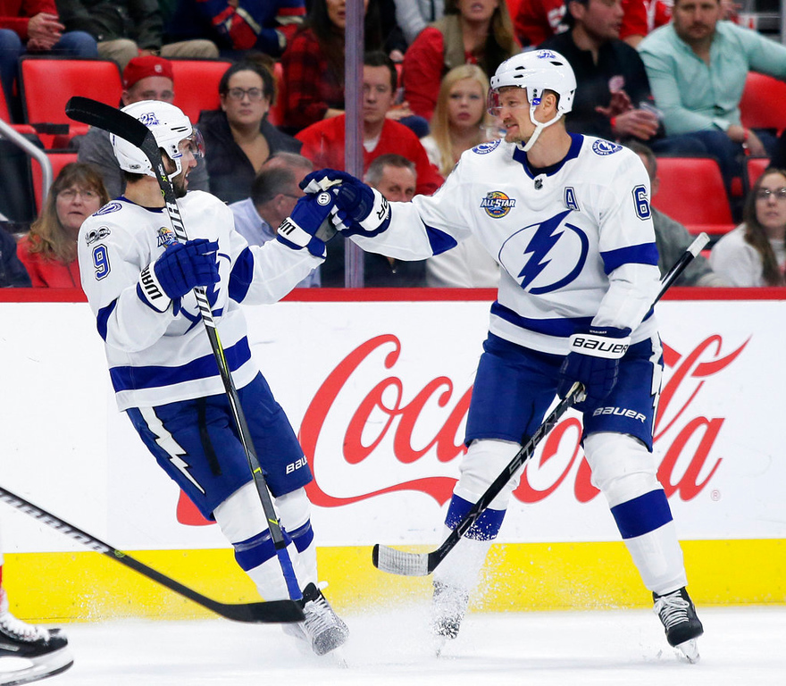 . Tampa Bay Lightning center Tyler Johnson (9) celebrates with defenseman Anton Stralman (6) after scoring against the Detroit Red Wings during the first period of an NHL hockey game Monday, Oct. 16, 2017, in Detroit. The Lightning defeated the Red Wings 3-2. (AP Photo/Duane Burleson)