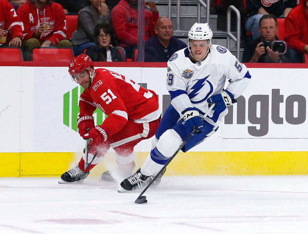 . Tampa Bay Lightning defenseman Jake Dotchin (59) steals the puck from Detroit Red Wings center Frans Nielsen (51), of Denmark, during the second period of an NHL hockey game Monday, Oct. 16, 2017, in Detroit. (AP Photo/Duane Burleson)