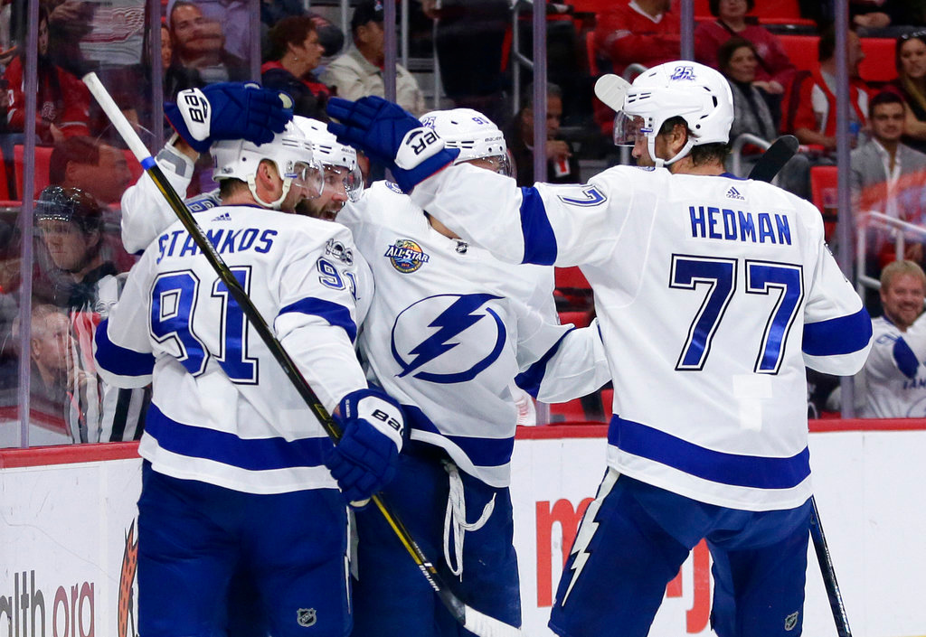 . Tampa Bay Lightning right wing Nikita Kucherov, of Russia, second from left, celebrates with teammates Steven Stamkos (91), Vladislav Namestnikov, of Russia, and Victor Hedman (77), of Sweden, after a first period goal against the Detroit Red Wings during an NHL hockey game Monday, Oct. 16, 2017, in Detroit. (AP Photo/Duane Burleson)