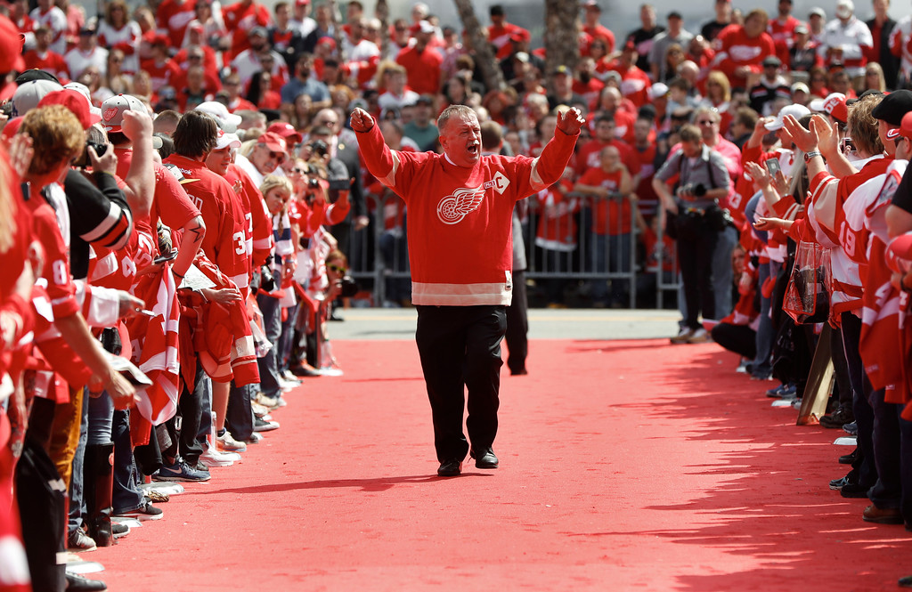. Joe Louis Arena building operations manager Al Sobotka greets fans before the final NHL hockey game at the stadium between the Detroit Red Wings and New Jersey Devils, Sunday, April 9, 2017, in Detroit. (AP Photo/Paul Sancya)
