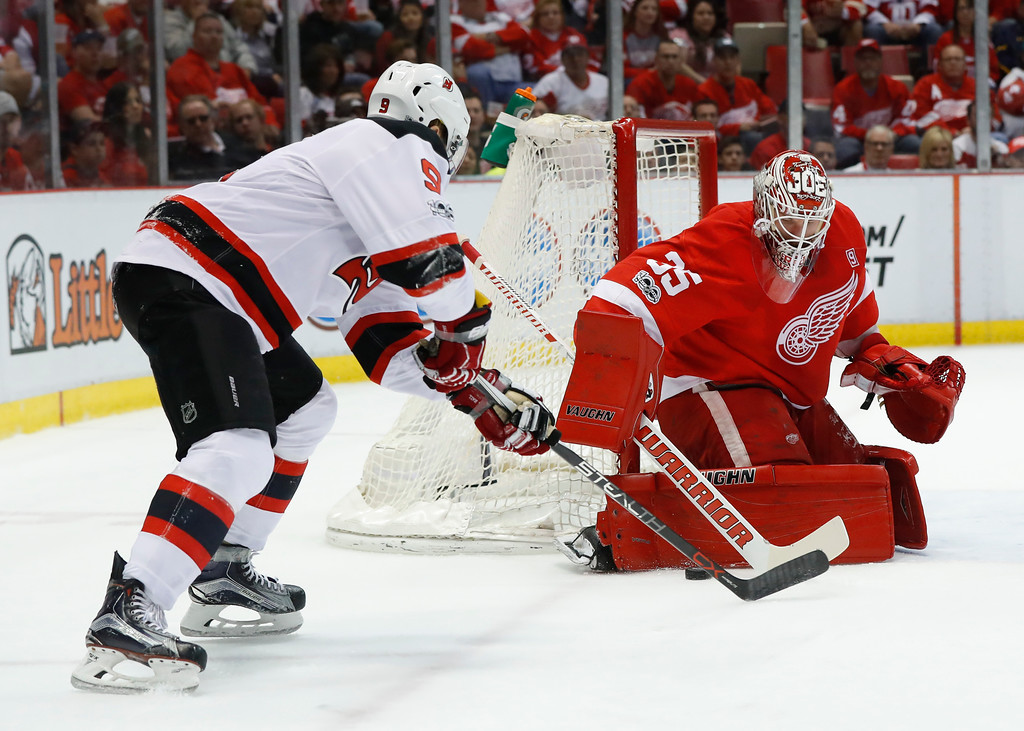. Detroit Red Wings goalie Jimmy Howard (35) stops a New Jersey Devils left wing Taylor Hall (9) shot during the first period of the final NHL hockey game at Joe Louis Arena, Sunday, April 9, 2017, in Detroit. (AP Photo/Paul Sancya)