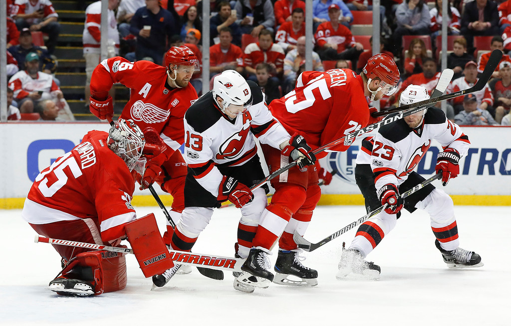 . New Jersey Devils right wing Stefan Noesen (23) shoots at Detroit Red Wings goalie Jimmy Howard (35) during the third period of the final NHL hockey game at Joe Louis Arena, Sunday, April 9, 2017, in Detroit. (AP Photo/Paul Sancya)