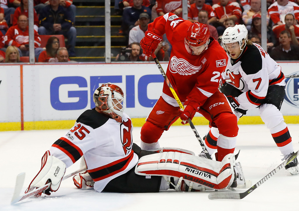 . New Jersey Devils goalie Cory Schneider (35) stops a Detroit Red Wings left wing Matt Lorito (22) shot during the second period of the final NHL hockey game at Joe Louis Arena, Sunday, April 9, 2017, in Detroit. (AP Photo/Paul Sancya)