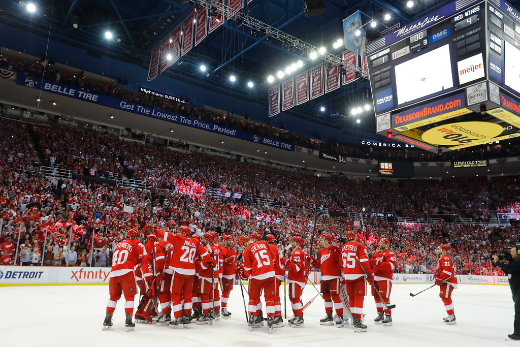 . Detroit Red Wings celebrate their 4-1 win against the New Jersey Devils after the final NHL hockey game at Joe Louis Arena, Sunday, April 9, 2017, in Detroit. (AP Photo/Paul Sancya)