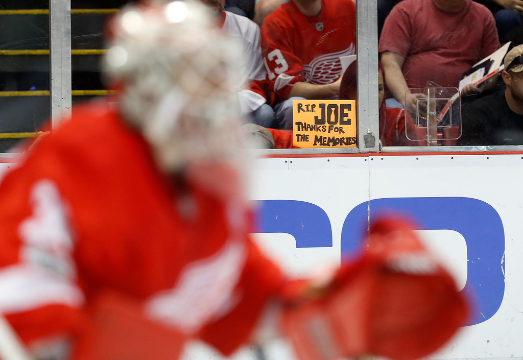 . A sign is shown as Detroit Red Wings goalie Jimmy Howard (35) tends goal against the New Jersey Devils during the first period of the final NHL hockey game at Joe Louis Arena, Sunday, April 9, 2017, in Detroit. (AP Photo/Paul Sancya)