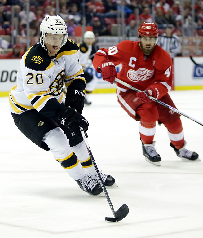 . Boston Bruins center Riley Nash (20) is pursued by Detroit Red Wings left wing Henrik Zetterberg (40), of Sweden, during the second period of an NHL hockey game Saturday, Oct. 29, 2016, in Detroit. (AP Photo/Duane Burleson)