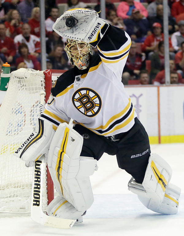 . Boston Bruins goalie Tuukka Rask (40) catches a high shot on goal against the Detroit Red Wings during the second period of an NHL hockey game Saturday, Oct. 29, 2016, in Detroit. (AP Photo/Duane Burleson)