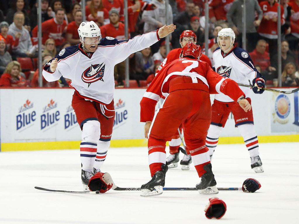 . Columbus Blue Jackets left wing Scott Hartnell (43) fights with Detroit Red Wings defenseman Brendan Smith (2) in the third period of an NHL hockey game Tuesday, Feb. 7, 2017, in Detroit. (AP Photo/Paul Sancya)