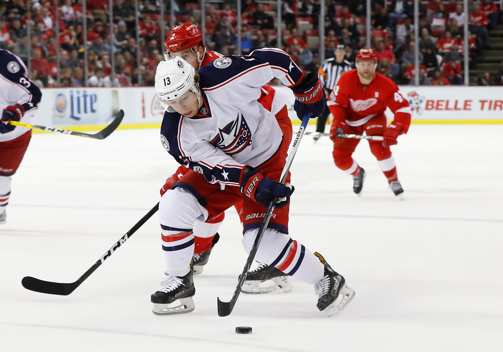 . Columbus Blue Jackets right wing Cam Atkinson (13) carries the puck against the Detroit Red Wings in the third period of an NHL hockey game Tuesday, Feb. 7, 2017, in Detroit. (AP Photo/Paul Sancya)