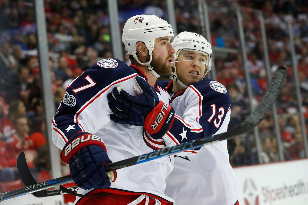 . Columbus Blue Jackets center Brandon Dubinsky (17) celebrates his goal against the Detroit Red Wings with Cam Atkinson (13) in the first period of an NHL hockey game Tuesday, Feb. 7, 2017, in Detroit. (AP Photo/Paul Sancya)
