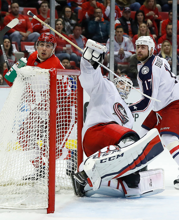 . Columbus Blue Jackets goalie Sergei Bobrovsky (72) deflects a Detroit Red Wings shot in the air in the second period of an NHL hockey game Tuesday, Feb. 7, 2017, in Detroit. (AP Photo/Paul Sancya)