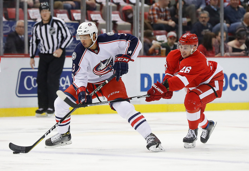 . Columbus Blue Jackets defenseman Seth Jones (3) protectst the puck from Detroit Red Wings right wing Tomas Jurco (26) in the first period of an NHL hockey game Tuesday, Feb. 7, 2017, in Detroit. (AP Photo/Paul Sancya)