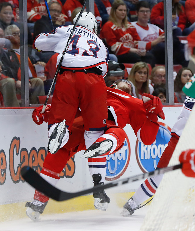 . Columbus Blue Jackets left wing Scott Hartnell (43) checks Detroit Red Wings defenseman Brendan Smith (2) in the first period of an NHL hockey game Tuesday, Feb. 7, 2017, in Detroit. (AP Photo/Paul Sancya)