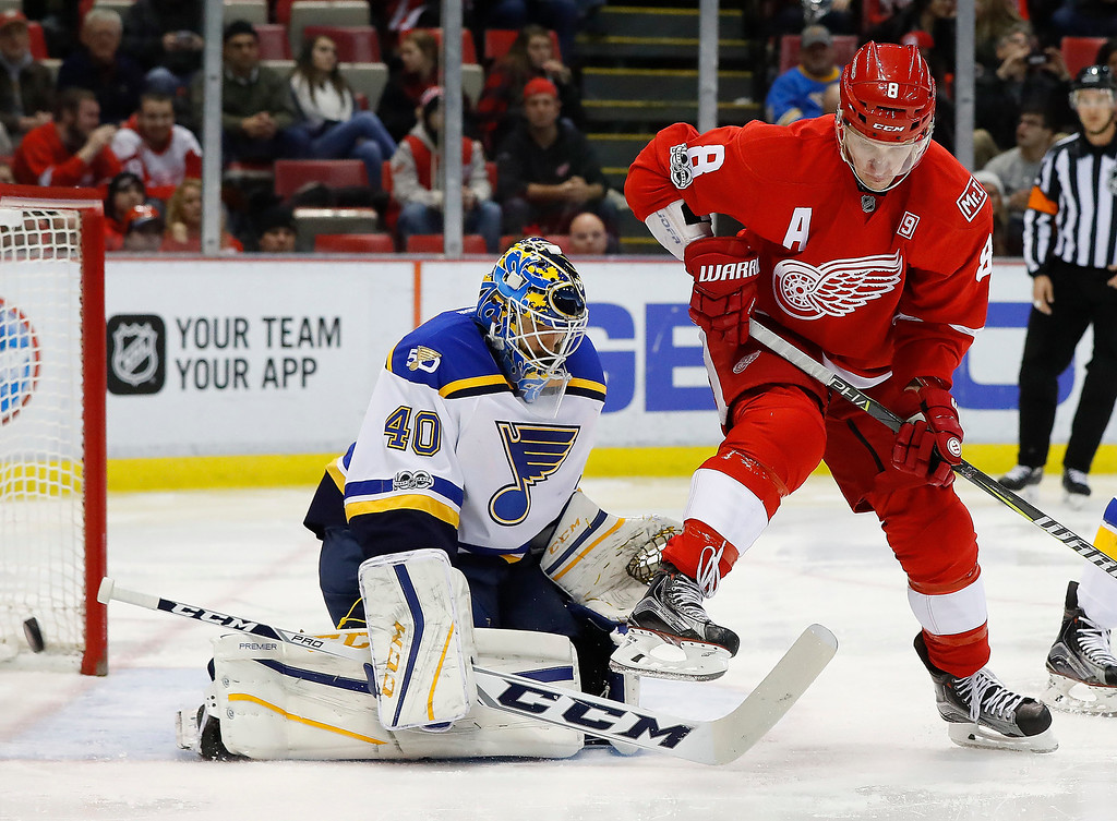 . Detroit Red Wings left wing Justin Abdelkader (8) screens a shot on St. Louis Blues goalie Carter Hutton (40) in the second period of an NHL hockey game, Wednesday, Feb. 15, 2017, in Detroit. (AP Photo/Paul Sancya)
