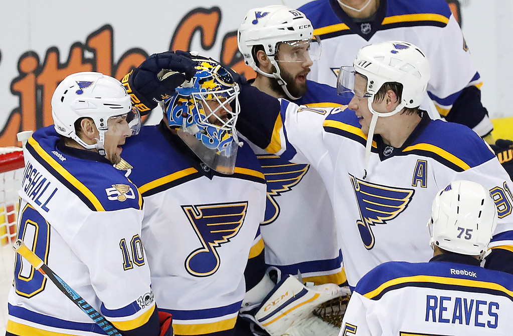 . St. Louis Blues goalie Carter Hutton, second from left, celebrates a 2-0 win against the Detroit Red Wings after an NHL hockey game Wednesday, Feb. 15, 2017, in Detroit. (AP Photo/Paul Sancya)